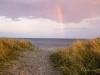 Strand mit Regenbogen
